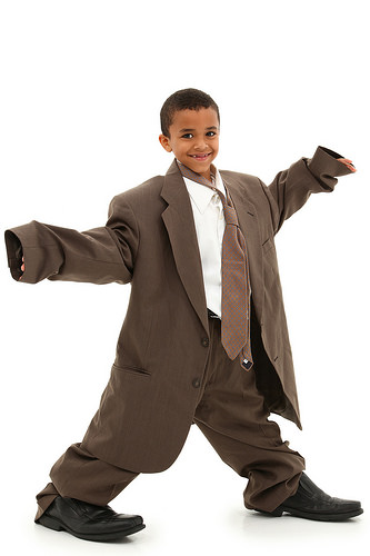 photo credit: Adorable Handsome Black Boy Child in Baggy Business Suit laughing and walking over white background. via photopin (license)